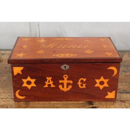 """This antique sailor's box is beautifully inlaid with nautical motifs and the name of a possible sweetheart: """"Annie."""" The..."""