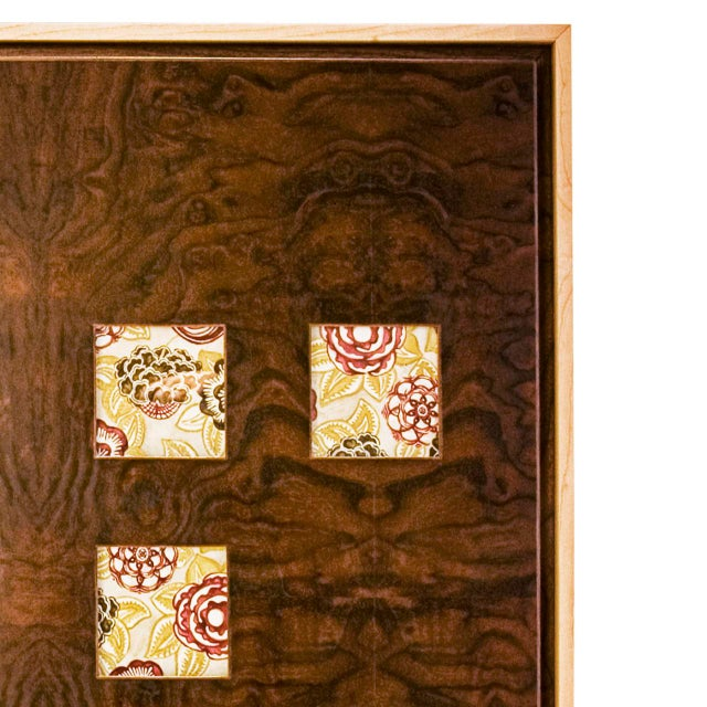 """Window"" cabinet in solid woods and burl veneers with cut-out windows in doors and bottom drawer. Interior of windows is..."