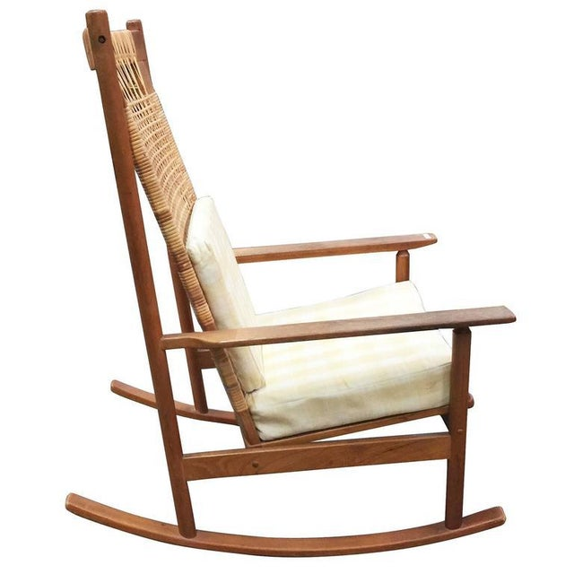 Rare Danish modern rocking chair designed by Hans Olsen for Juul Kristiansen in 1958. The frame is made of teak with a...