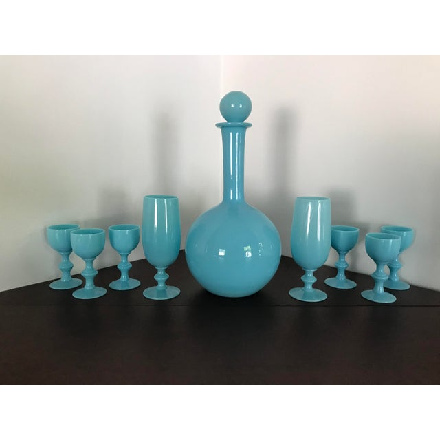 A beautiful set of antique French blue opalescent glass cordial goblets and matching decanter with stopper. This set...