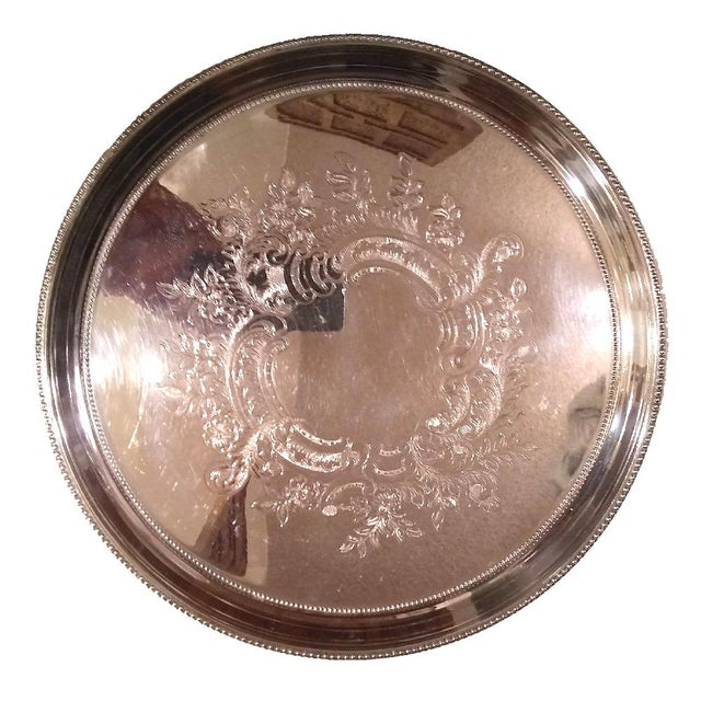 "Lavishly embossed tray beautiful enough to stay on display even when not in use. 12"" silverplate Towle tray...good..."
