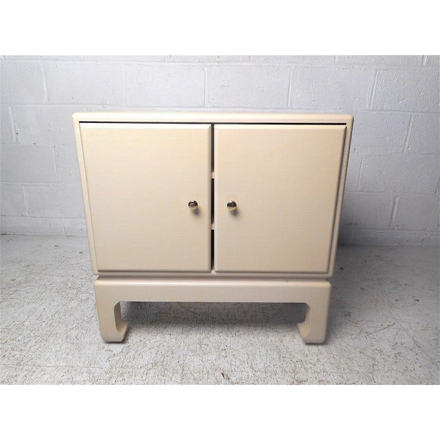 Beautiful midcentury compact free-standing cabinet. Linen-wrapped piece with a finished back. Stylish addition to any...