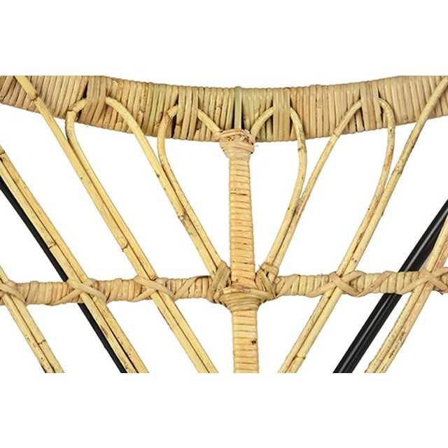 Rattan butterfly scoop chair with black matte iron frame. Unique woven rattan design. Great indoors or outdoors in a...