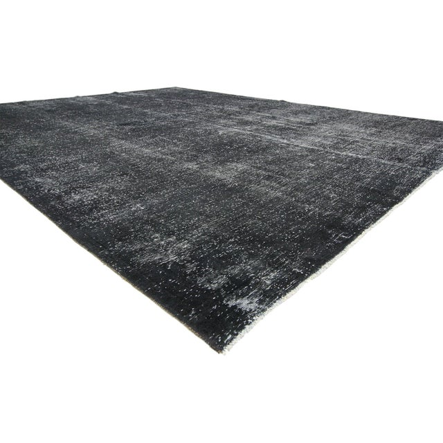 60697 Distressed Vintage Turkish Dark Charcoal Rug with Industrial Steampunk Style 09'04 x 12'02. Defined and raw combined...