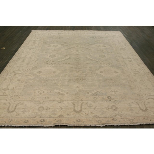 Hand-knotted rug with a floral design on a beige field with gray borders. This rug has magnificent detailing and would be...