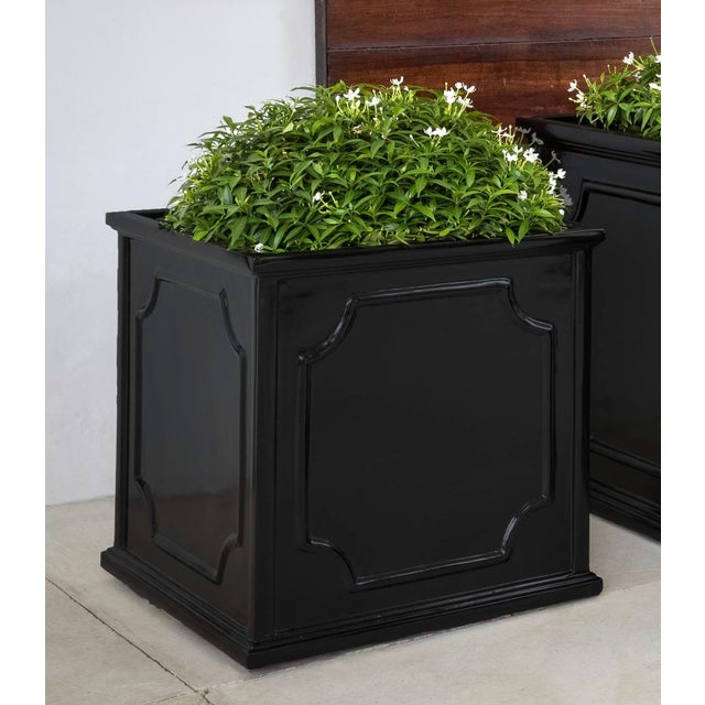 A square planter of Fiber Clay Composite in a glossy black finish. Available in multiple sizes or as a set of three. This...
