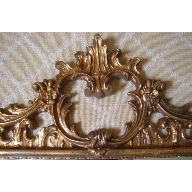 Fancy large vintage burnished gold Chippendale design mirror with elaborate top and bottom crests, drapery swags dripping...
