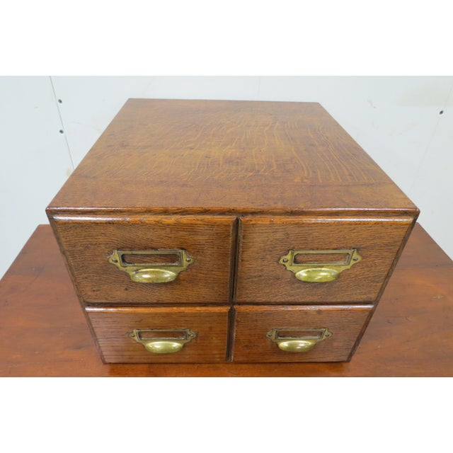 This is a wonderful tiger oak tabletop card file with 4 drawers. The wood graining is beautiful and everything is in...