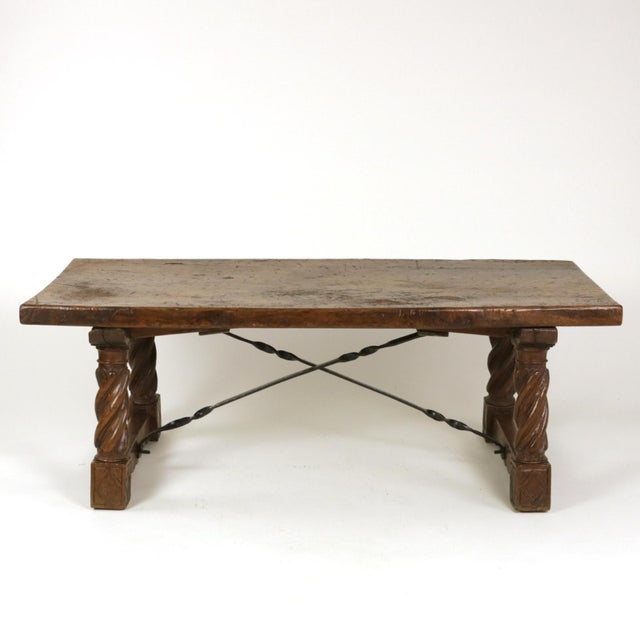 Italian Walnut Low table with carved barley twist legs and twisted iron cross stretchers, circa 1800 height: 19 in. 48.25...