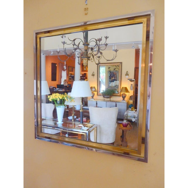 1960's Italian Romeo Rega brass, chrome and lucite mirror. Very high quality mirror typical of Romeo Rega designs. We have...