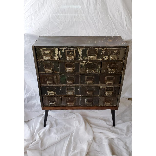 This industrial cabinet/hall table was truly a labor of love! I found it at an auction looking pitiful with layers of...