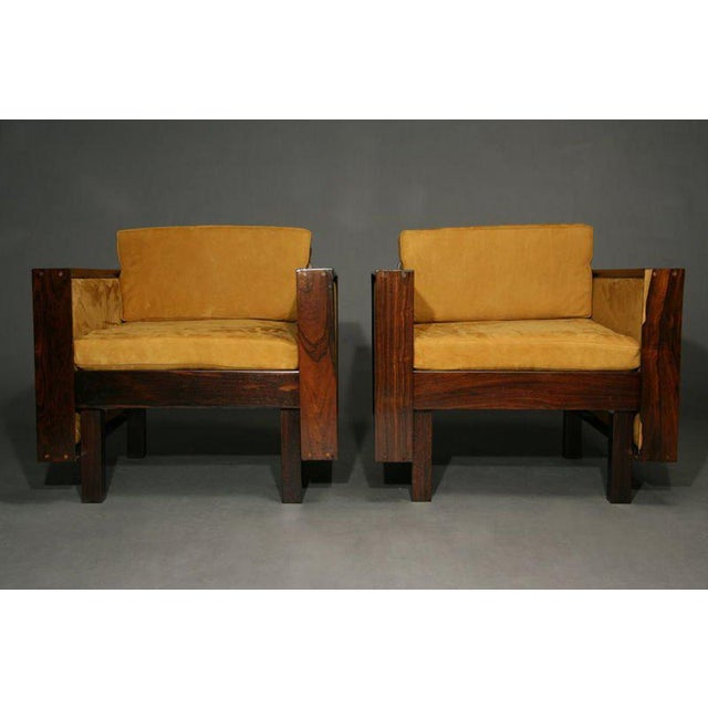 A pair of very cool 60's mid-century Brazilian rosewood and suede arm chairs by Fatima Architects in Rio de Janeiro....