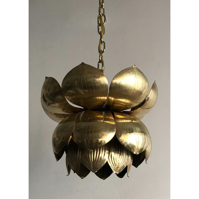 Glamorous, 1970s brass pendant chandelier in the form of a lotus blossom by Feldman Lighting, Los Angeles. This petite-...
