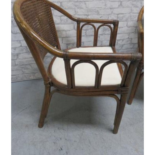 McGuire rattan style chairs With lovely cane backs A Pair Beautiful design Sturdy chairs