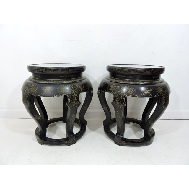 A pair of Chinese garden stools, side tables or pedestals on five ruyi legs ornately hand painted with gold flowers,...