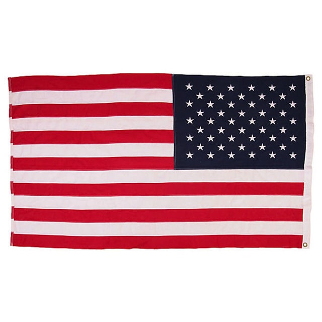 """Vintage 50 star US flag with brass grommets for hanging. Stamped: """"Bulldog Bunting, Dettras Flag Products."""""""