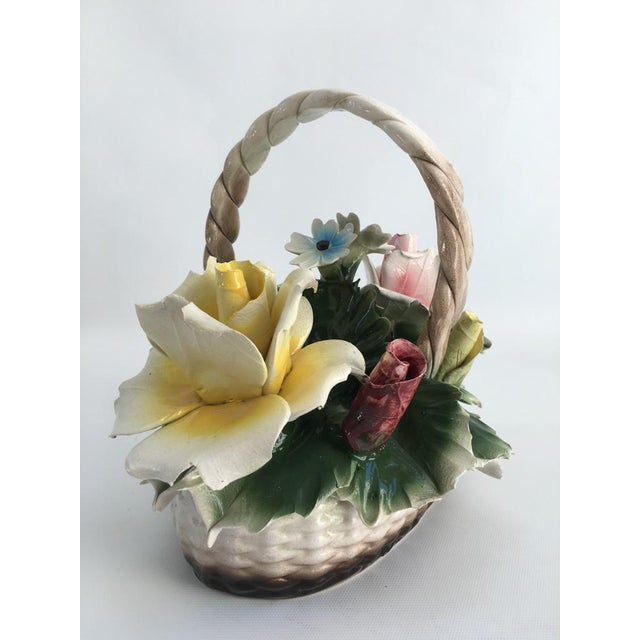 Crown Capodimonte Italian hand-decorated porcelain handled basket with large pink and yellow roses. Maker's mark on...