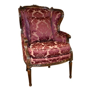 Antique Carved French Style Burgundy Patterned Wing Chair For Sale