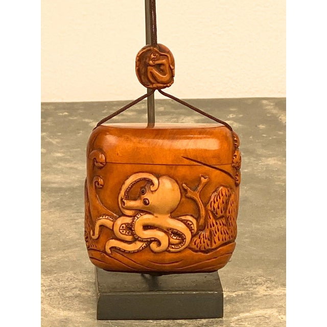 A Vintage Japanese Taisho Period Inro or medicine container with an octopus, circa 1920.