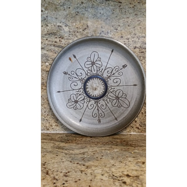 No bids accepted on this piece. Very attractive hand thrown, etched and painted tray or platter. Spans a plethora of...