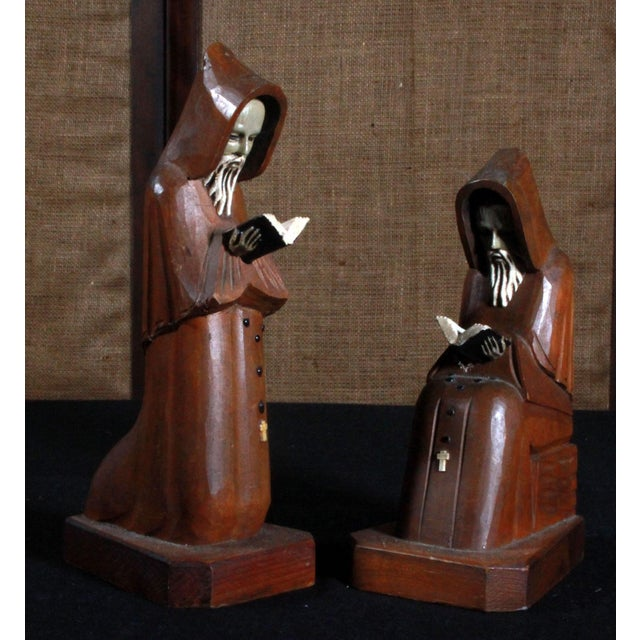 Here's a very cool pair of vintage c.1950's hand carved Mexican Monk figures! The hands and bible they are folding are...