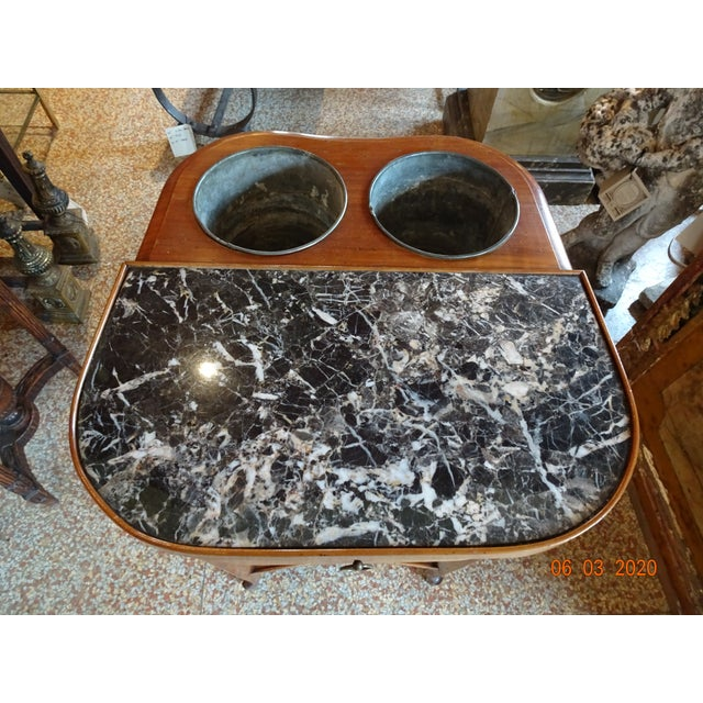 Fabulous French maple wood rafraichissoir with one large drawer , a white and black marble top and two tole buckets....