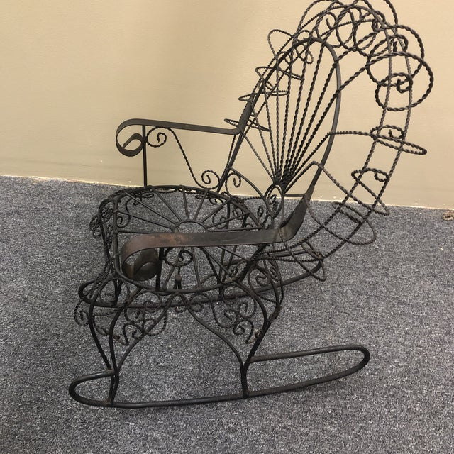 Wrought metal peacock style child's rocking chair from an estate in Richmond, Virginia.