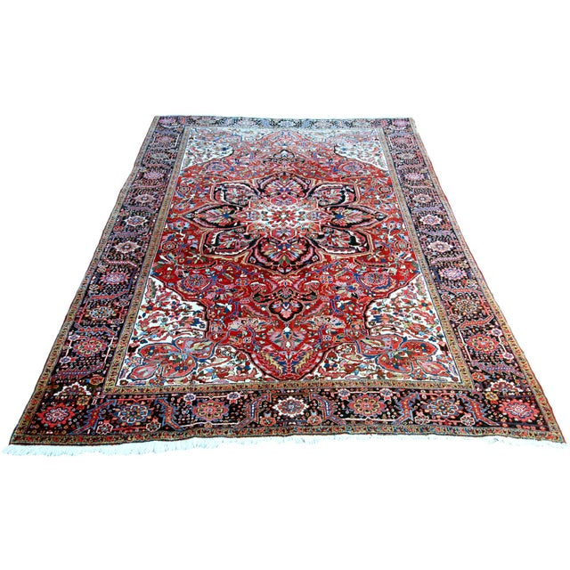 Antique Persian Heriz rug circa the 1930s, measuring 9 feet 11 inches by 13 feet 1 inch. Beautiful design with massive...