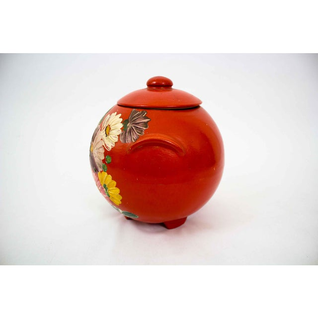 Gorgeous hand painted red pottery vessel, c. 1940. Perfect for hiding unsightly tech items on a bookshelf or entryway buffet.