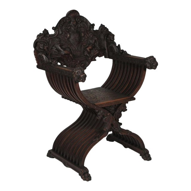 1890 Gothic Revival Heavily Carved Campaign Chair For Sale