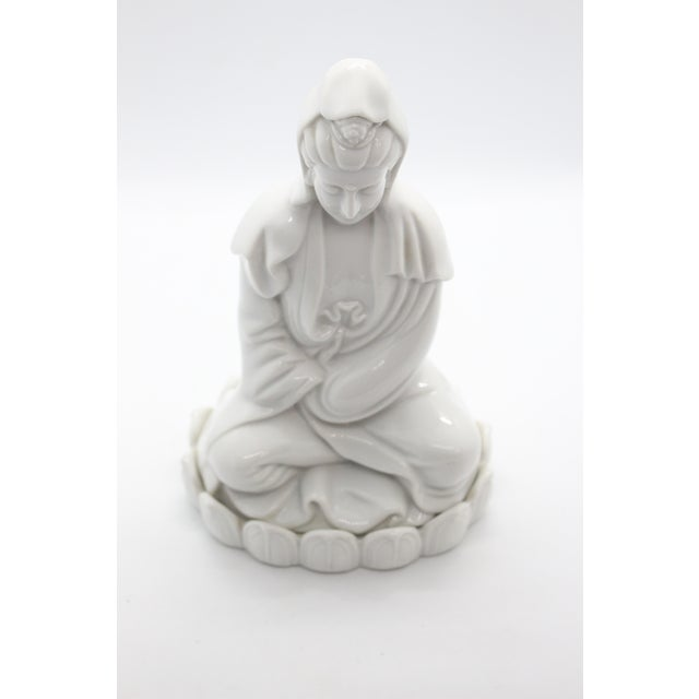 Beautifully articulated and hand-assembled Blanc-de-Chine white porcelain serene faced Quan Yin seated within a lotus...