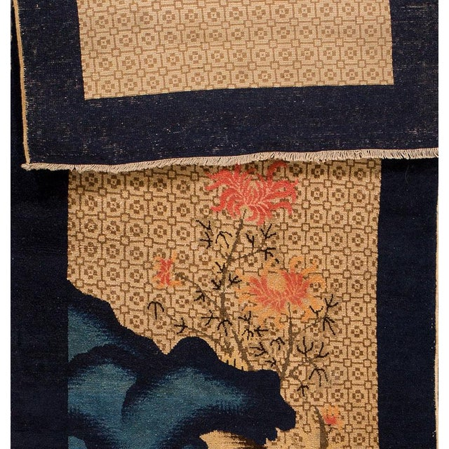 Apadana - Antique Chinese Peking rug, with a dark blue border and beige field. Features a pictorial design, with a tree,...