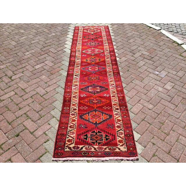 This gorgeous hand knotted vintage anatolian runner rug is approximately 70 years old in excellent vintage condition. The...