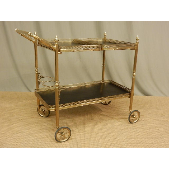 Very nice vintage brass bar cart with three detachable trays.