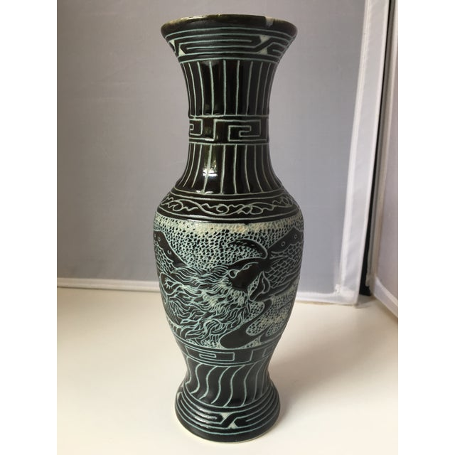 Black painted porcelain Vase, with etched detail revealing aqua chinoiserje detail. Signed on base as shown.