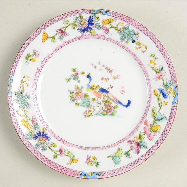 Noritake Pink with Bird of Paradise (N1397) Bread & Butter Plate Set of 9 features multicolor floral rim with pretty pink...