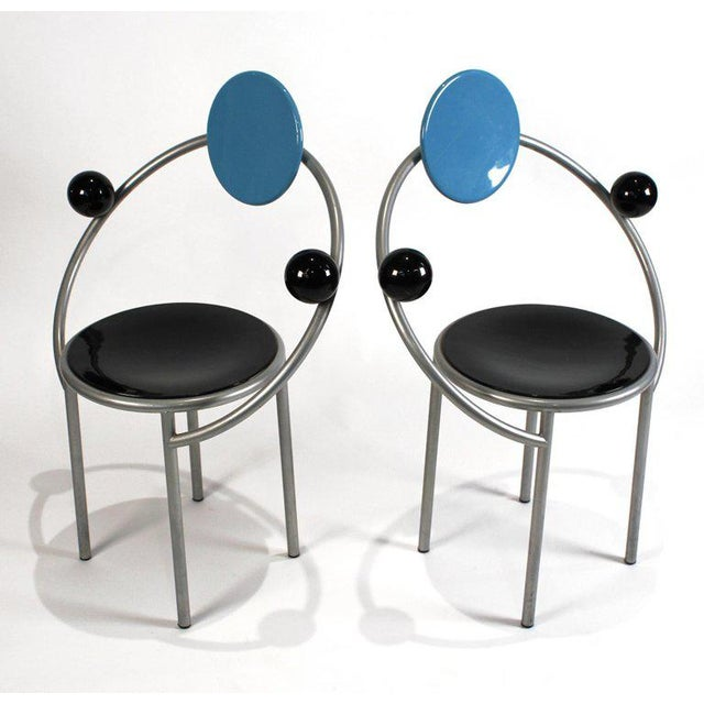 Pair of futuristic chairs designed in 1984 by Memphis designer Michele De Lucchi. Signed to underside.