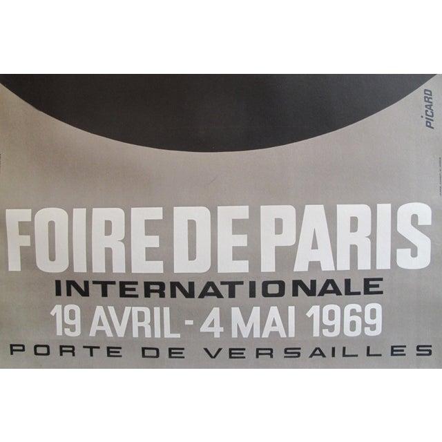 Date: 1966 Size: 29 x 33 inches Artist: Picaro This poster advertises the 1966 edition of the Foire de Paris (Paris Fair),...