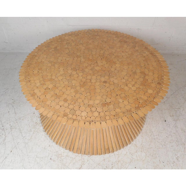 This beautiful vintage modern coffee table is made of bamboo rattan and designed by McQuire. A unique hourglass shape with...