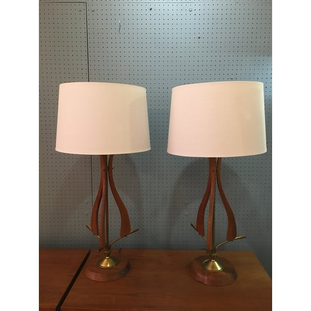 Nice pair of Scandinavian Modern Table Lamps with Brass Accents. Nice Original Condition with a rich wood finish and...