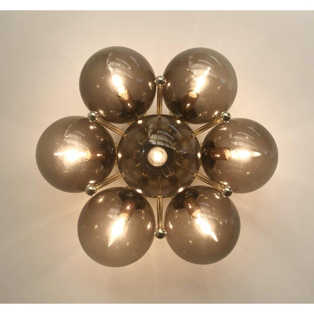 Italian modern flush mount or wall light with 7 smoky Murano glass globes mounted on chic polished brass finish / Designed...