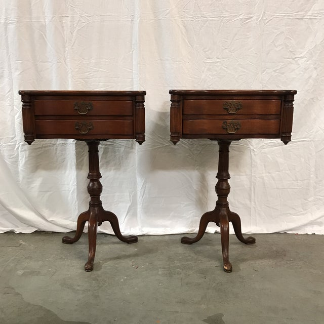 Stately mahogany library tables with beautiful Empire detail and brass handles. Some light wear on table tops and feet, as...