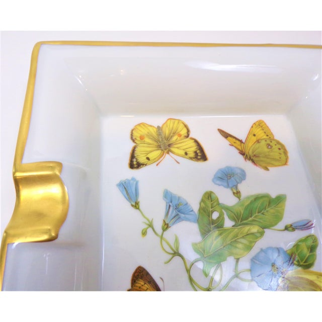 This is a hand painted limoges porcelain Cigar Tray in an Hermes style design. This square shaped limoges tray was...