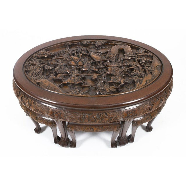 a low profile carved wooden coffee table depicting a chinese battle scene under a - Carved Wooden Coffee Tables