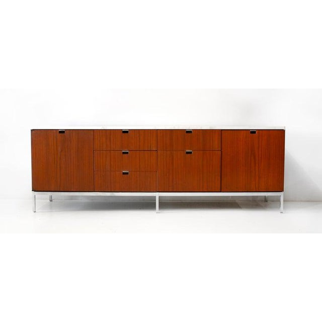 Beautiful credenza designed by Florence Knoll for Knoll International. Constructed with teak wood, marble top and oak...
