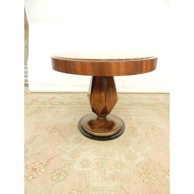 Beautiful inlay combined with lovely warm walnut patina. An Art deco table that makes a real statement.