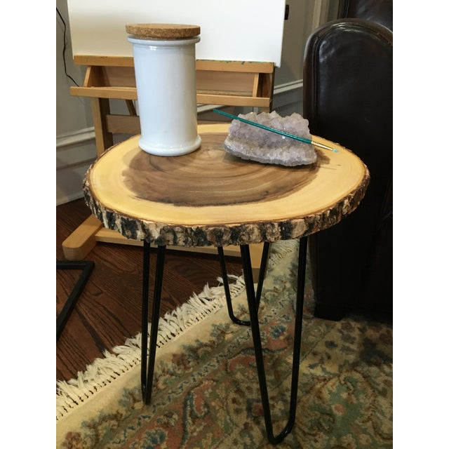 Wonderful teak wood natural and metal accent side table. The legs will be unscrewed and taken off for shipping.