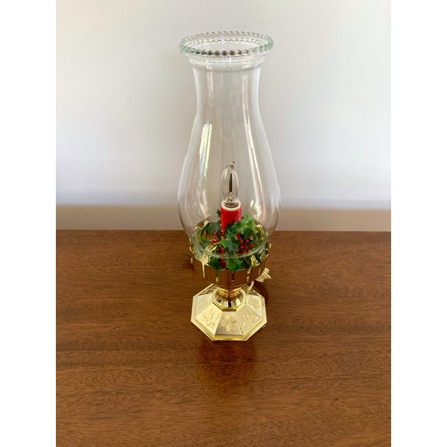 Vintage flameless candle with faux Holly Berries, gold plastic base, and glass removable hurricane. Original wiring in...