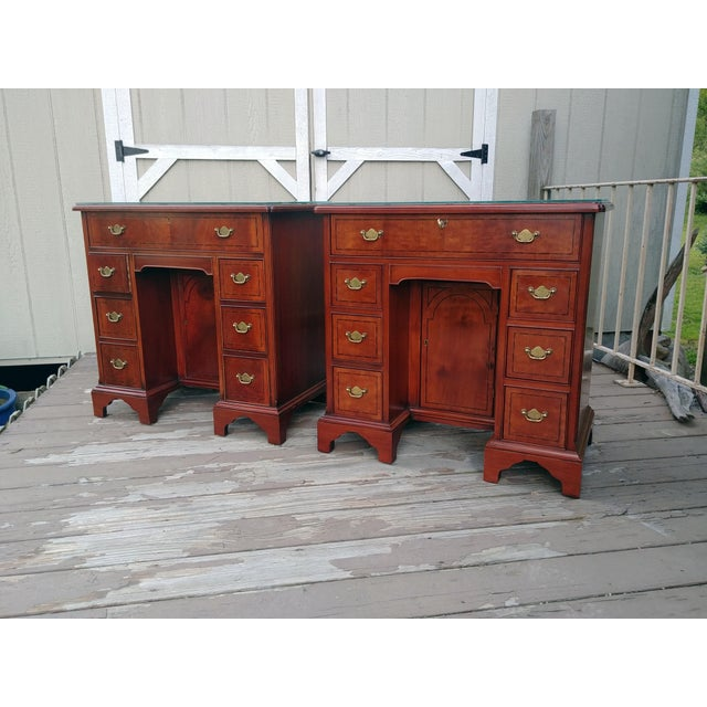 Item offered is a pair of stunning rare Hickory Chair Furniture Company Mahogany French Bureau Tables [small knee hole...
