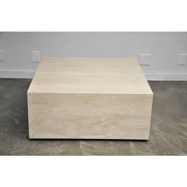 Travertine coffee table on castors for mobility.